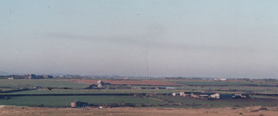 In unusual weather  on 13 January 2001 smoke from the 400ft stack (near centre of photo) at Anglesey Aluminium lingering over NW Anglesey. Photo: © 2001 D. Perkins