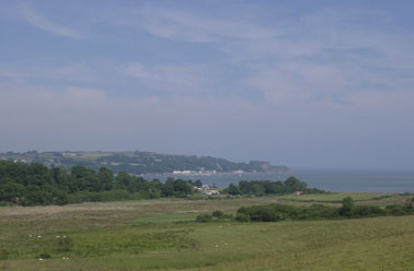 View across the Afon Nodwydd estuary to Traeth Goch (Red Wharf Bay) and the 'Ship Inn' on 5 July 2001. Photo: © D. Perkins.